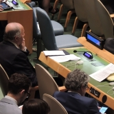 Laurent Fabius sitting in the general assembly at the UN