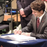 Justin Trudeau signing for Canada