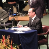 President of France Francois Hollande signing the treaty