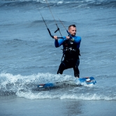 Kitesurfer getting ready to catch a decent wave